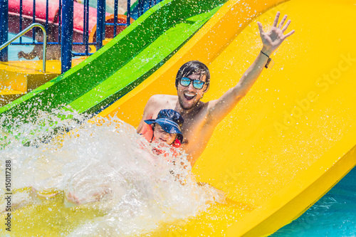 Papiers peints Attraction parc Father and son on a water slide in the water park