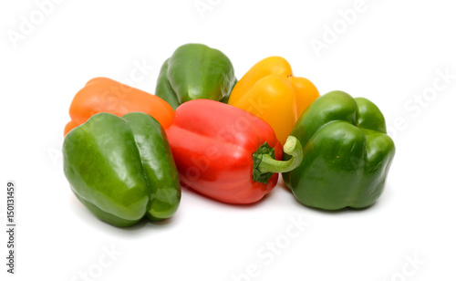 Fotobehang Groenten Fresh colorful bell peppers on the white background