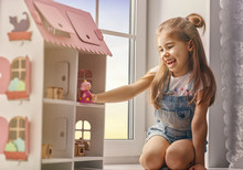 Girl Plays With Doll House