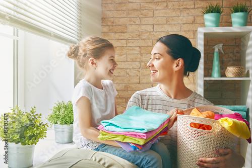 Fotografia, Obraz  family doing laundry at home