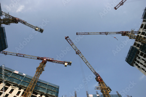A view of construction cranes at the site of the under
