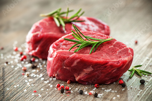 Fototapeta Raw beef fillet steaks with spices