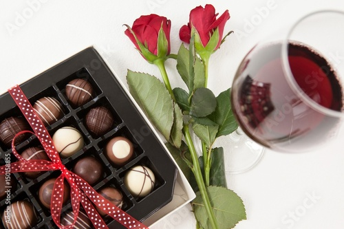 Bunch of roses, champagne bottle, wine glass
