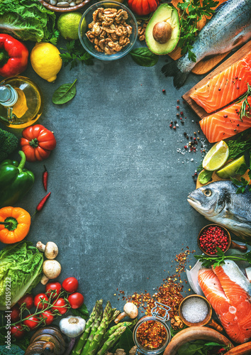 Assortment of fresh fish with aromatic herbs, spices and vegetables