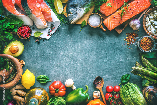 Obraz Assortment of fresh fish with aromatic herbs, spices and vegetables - fototapety do salonu