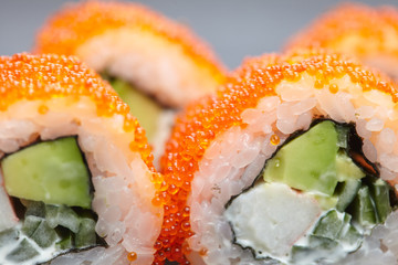Fototapeta fish roe sushi avocado cheese, sesame