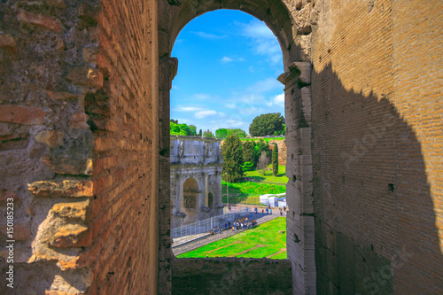 Photo  View of the Triumphal Arch of Constantine through the arch of the Colosseum