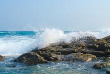 Waves Of The Ocean Break Into Splashes Of Dark Stones. Southern Province. Sri Lanka