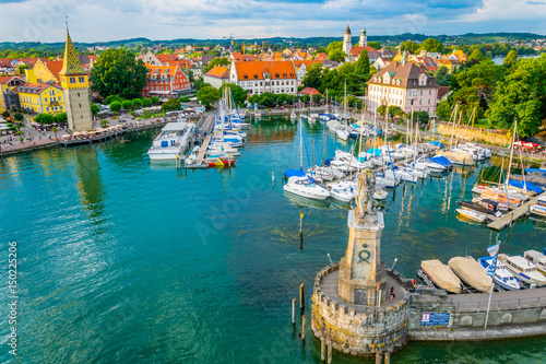 Foto op Plexiglas Venetie Aerial view of the german port Lindau including Mangturm tower and a lion statue.