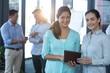Portrait of businesswomen using digital tablet