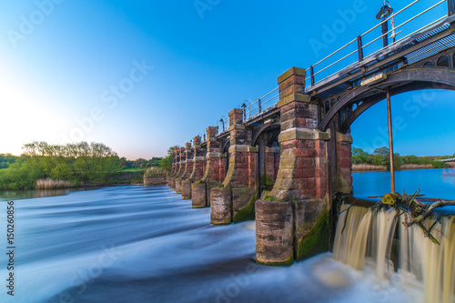 Canvas River weaver sluice gates Northwich Cheshire UK at sunset