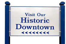 VISIT OUR HISTORIC DOWNTOWN Town Welcome Sign. Isolated.