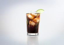 Famous Classic / Popular Cocktail Drink: Cuba Libre. Made With Rum, Coke, Lemon / Lime And Ice. Isolated On White Background.
