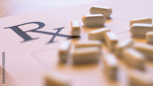 Prescribing, overprescribing prescription pills concept with blank RX form and falling tablets, close up in natural light, shallow DOF Canvas Print