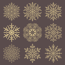 Set Of Vector Golden Snowflakes. Fine Winter Ornament. Snowflakes Collection. Snowflakes For Backgrounds And Designs