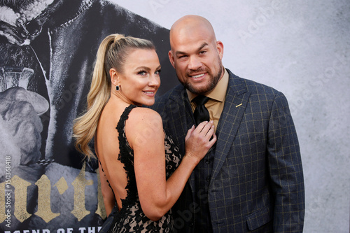MMA fighter Tito Ortiz and Amber Nichole Miller pose at the premiere
