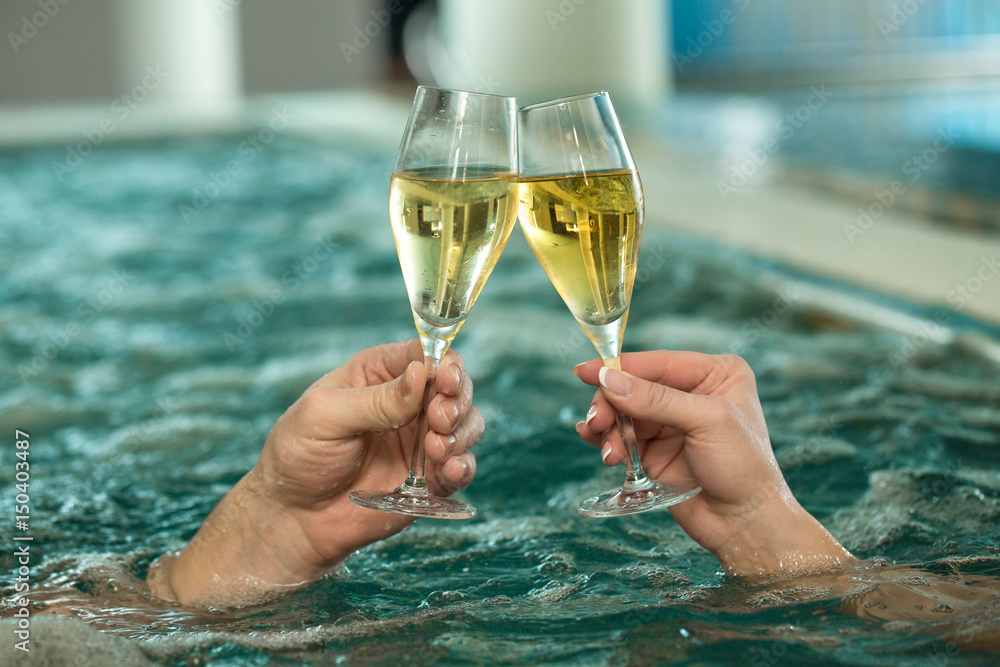 Fototapeta Beautiful loving couple relaxing in a jacuzzi tub together