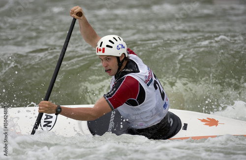 Craig Allen of Canada paddles his way to the next gate in