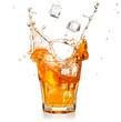ice cubes falling into a splashing orange cocktail