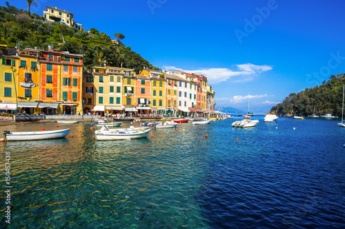 Canvas Prints Liguria PORTOFINO, ITALY, APRIL 8, 2017 - View of Portofino, an Italian fishing village, Genoa province, Italy. A tourist place with a picturesque harbour and colorful houses