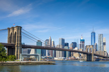Scenic View Of Brooklyn Bridge And The Lower Manhattan Skyline On A Bright Day On The East River In New York City