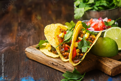 Fotografie, Obraz  Traditional Mexican tacos with tomatoes, meat, herbs