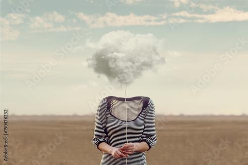 Fotografía Woman's head hidden by a soft cloud