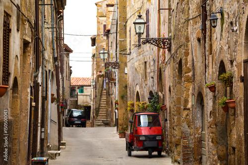 Foto op Plexiglas Aap Piaggio Ape at the empty street