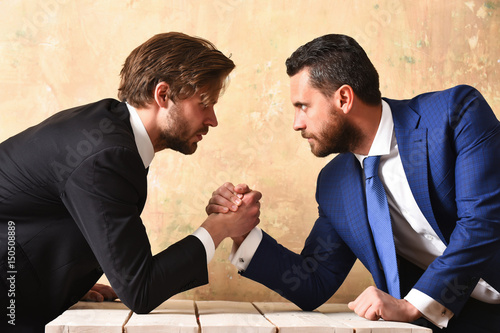 Fotografiet  Rivalry concept. Businessmen arm wrestling.