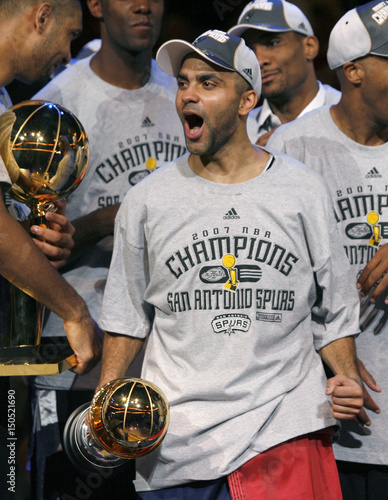 8eebe3936098 San Antonio Spurs Tony Parker celebrates with the MVP trophy after  defeating the Cleveland Cavaliers to