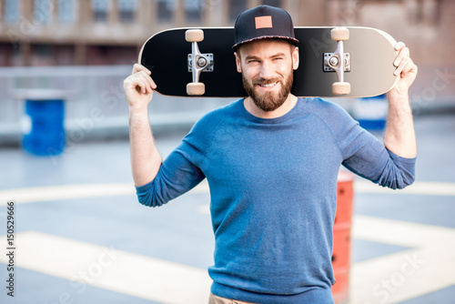 Portrait of a man with skateboard