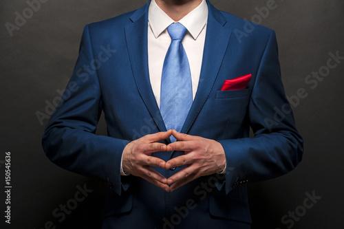 Stampa su Tela  Man gentleman in black suit and tie