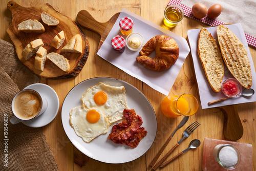 Continental breakfast croissant eggs bacon bread