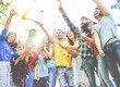 canvas print picture Happy friends enjoying party,throwing confetti and using smoke bombs colors at party outdoor