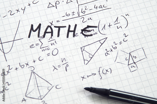 Word Mathe (German for Math) in handwriting on checkered