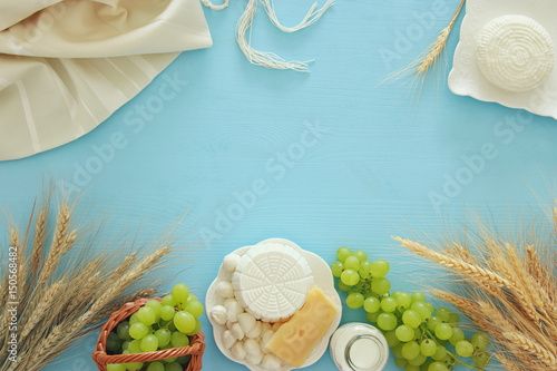 Fotobehang Zuivelproducten dairy products and fruits. Symbols of jewish holiday - Shavuot