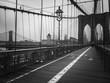 Brooklyn bridge walkway in black and white
