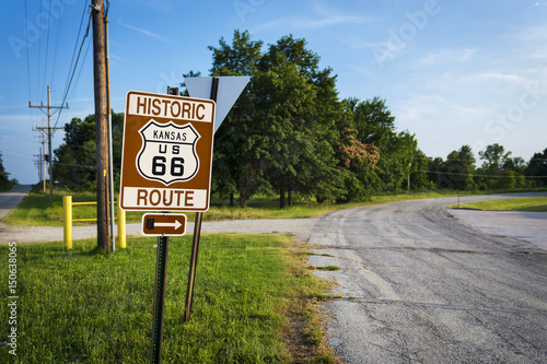 Historic Route 66 road sign in a strecht of the original road in the State of Kansas, USA; Concept for travel in the USA and Road Trip