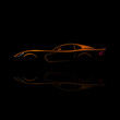 Orange sport car silhouette with reflection on black background.