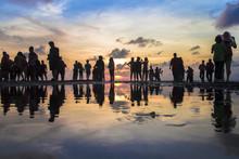 Beautiful Silhouette Of Photographers And Tourist Photographing The Sunset At Kuta Beach, Bali, Indonesia