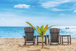 Beautiful Beach landscape with two deck chairs, blue sky, sand, sun, and sea, vacation concept