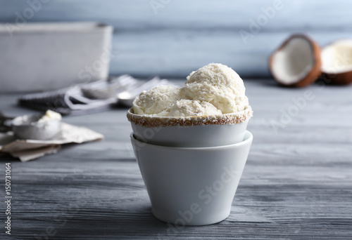Acrylic Prints Cat Serving cups with balls of coconut ice cream on grey table
