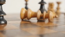 Shallow DOF End Of Game Of Wooden Chess Match Slow-mo 1920X1080 HD Footage - Slow Motion Of White Set Player King Fall On Chequered Fields Close-up 1080p FullHD Video