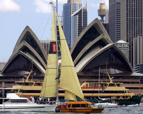 The yacht BG Spirit passes the Sydney Opera House surrounded