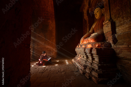 Novice monks in the plain of bagan on during sunrise,Myanmar ancient,Myanmar rel Canvas Print