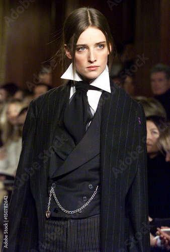 A model wears a cashmere robe with a black wool double