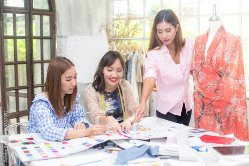 Young Team Asian Designer Woman Warking At Studio Fashion Designer Carefully Creating New Fashionable Styles Dressmaker Makes Clothes Via Additional Part Time Job Buy This Stock Photo And Explore Similar Images At