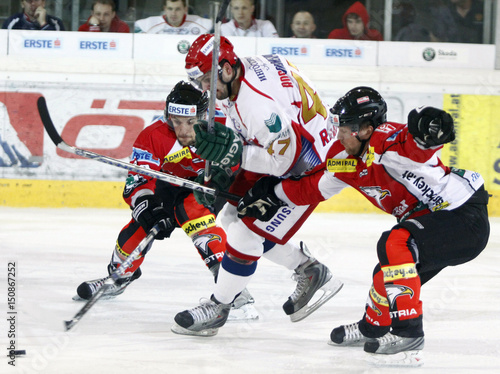 Russias Alexander Radulov Fights For The Puck With Austrias