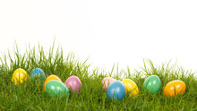 Colored Easter Eggs Lying In The Grass On A White Background