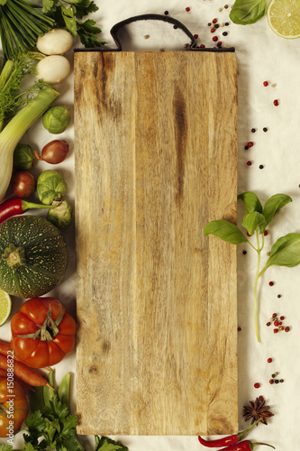 Vegetables, herbs, spices and empty cutting board Canvas Print